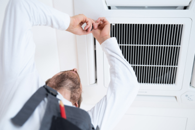 Air conditioning engineer performs an assessment